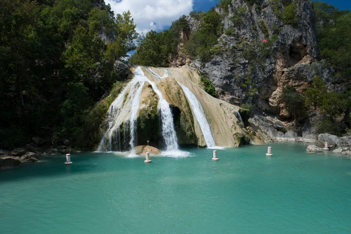 Beautiful Turner Falls on a bright sunny day. Turner Falls is one of the two Oklahoma's tallest waterfalls.