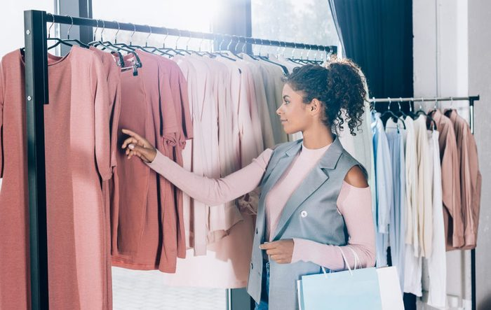 beautiful young woman on shopping in clothing store