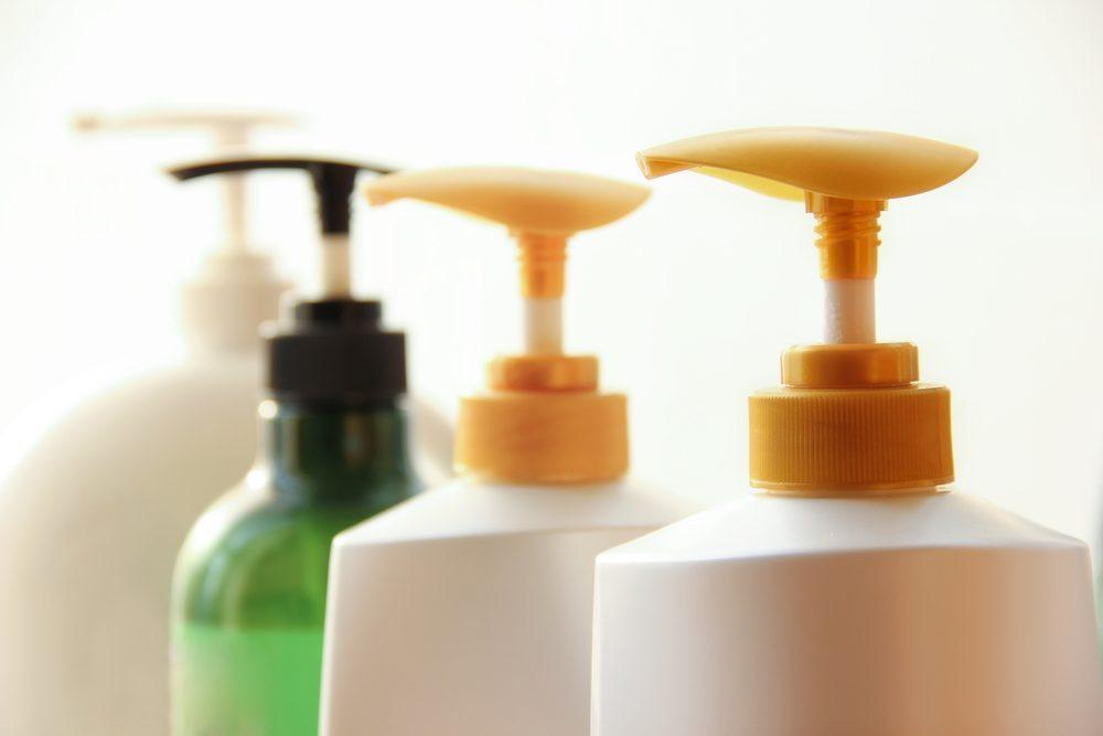 Shampoo bottles high key image.
