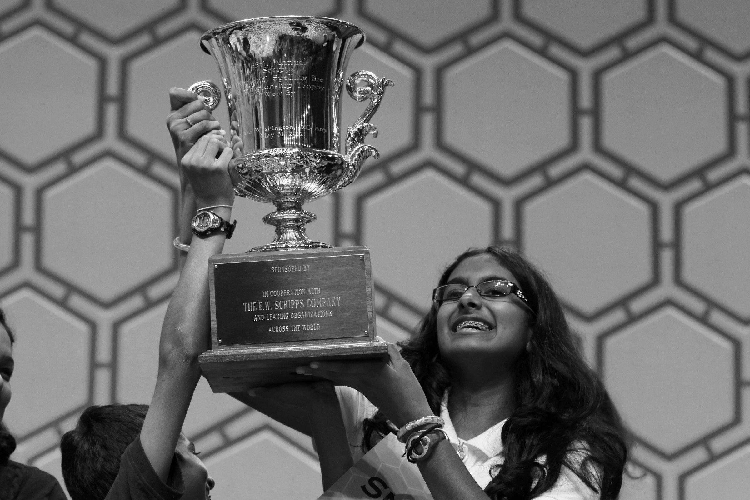 """Snigdha Nandipati Snigdha Nandipati, 14, of San Diego, right, and her brother Sujan Nandipati, hoist up her trophy after she won the National Spelling Bee with the word """"guetapens"""" in Oxon Hill, Md., on"""