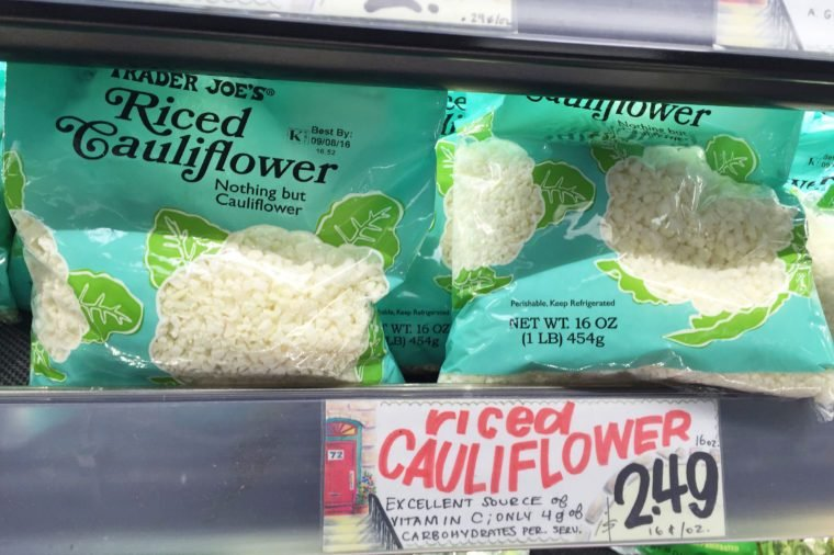 "This, photo shows riced cauliflower for sale at a Trader Joe's in New York. Swapping out the rice and potatoes in dishes with chopped-up cauliflower gained traction with followers of the Paleo diet and others mindful of their carbs. Now, several companies are trying to take advantage of the trend. Trader Joe's began selling frozen ""Riced Cauliflower"" last year and a fresh version this year"