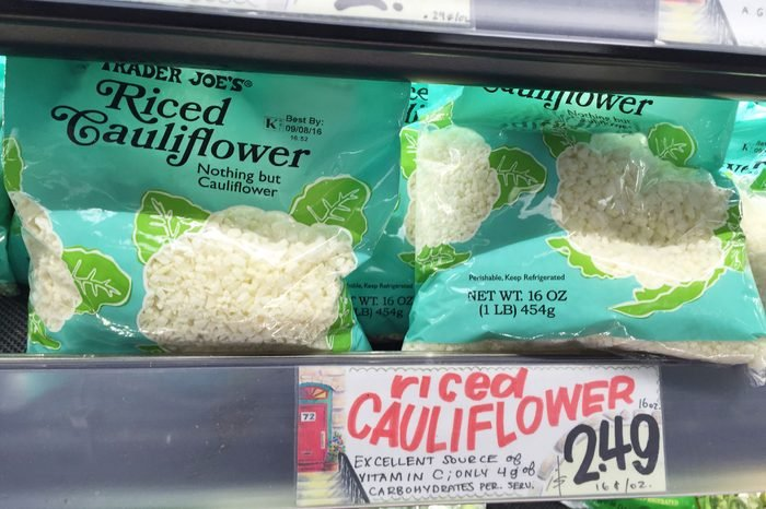 """This, photo shows riced cauliflower for sale at a Trader Joe's in New York. Swapping out the rice and potatoes in dishes with chopped-up cauliflower gained traction with followers of the Paleo diet and others mindful of their carbs. Now, several companies are trying to take advantage of the trend. Trader Joe's began selling frozen """"Riced Cauliflower"""" last year and a fresh version this year"""