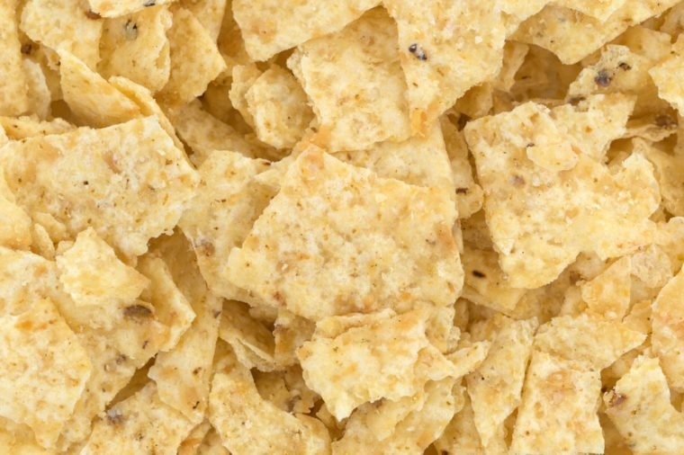 A very close view of broken tortilla chips.