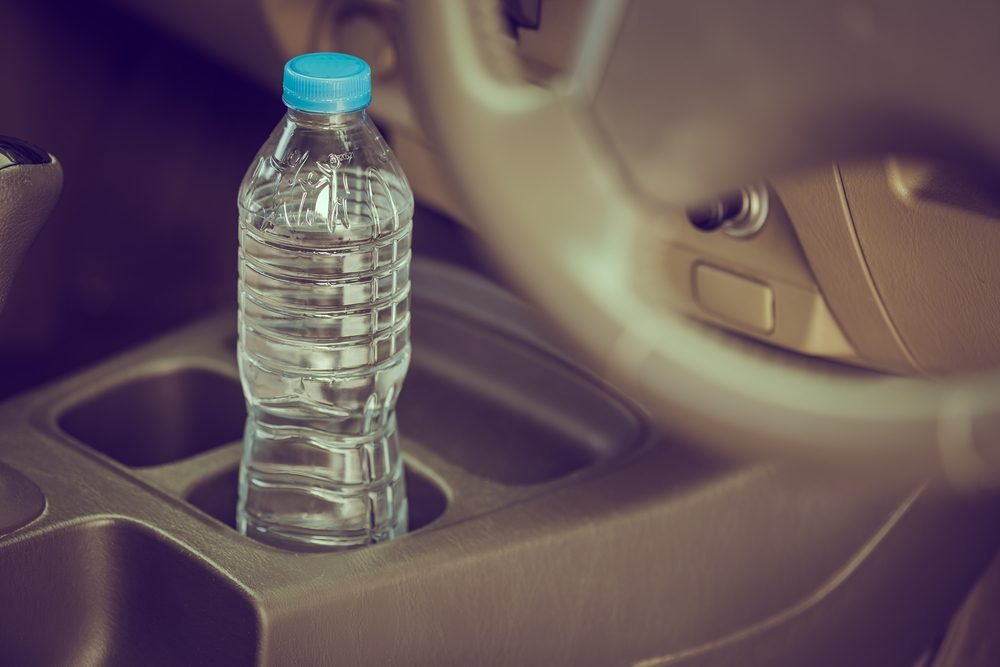 image concept Bottled water was left in the car for a long time. To drink it?