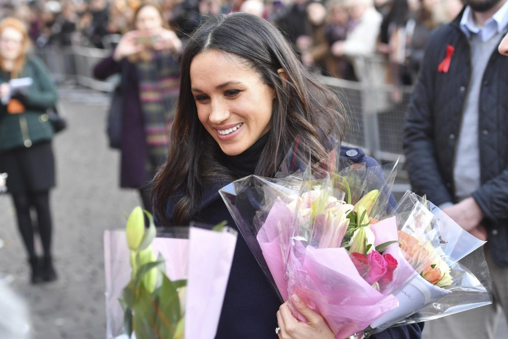 Meghan Markle receives flowers from fans