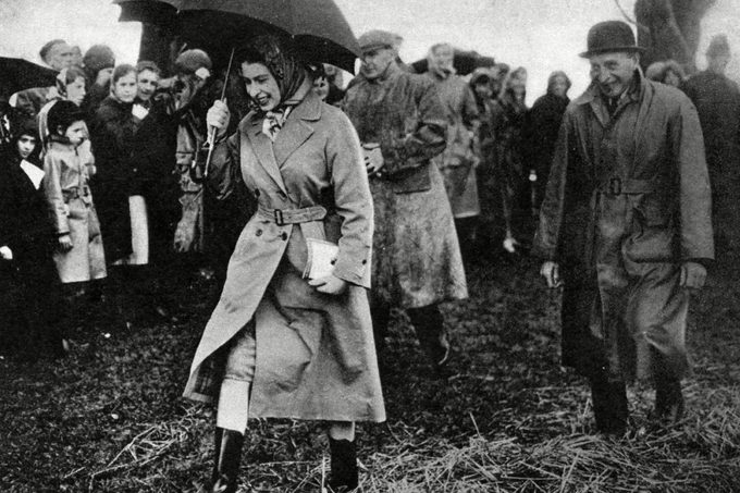 The Queen Well Protected From the Rain Walks Across A Muddy Field to Watch the Dressage at the Badminton Horse Trials 1959 1959