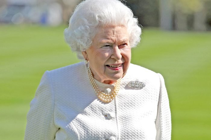 Queen Elizabeth II during the unveiling of a panel marking the walkway in Buckingham Palace gardens, London, in relation to the Commonwealth Walkway project.