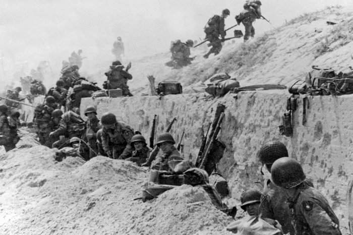 Normandy, France: June 9, 1944. American troops of the 4th Infantry Division at Utah Beach taking a breather before continuing the assault over the hill to the interior of France.