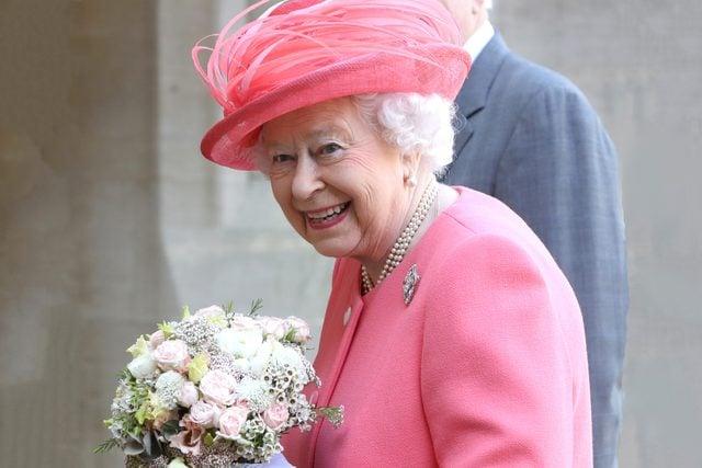 Queen Elizabeth II smiles after she started the London Marathon from Windsor Castle