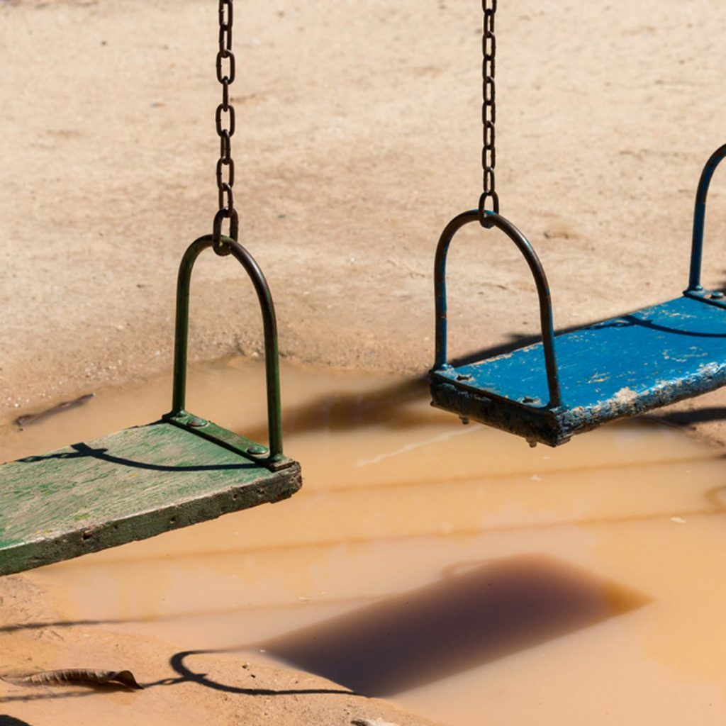Swingset over a puddle on a playground