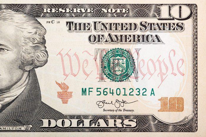 Part of ten dollar bill �¢?? American money.