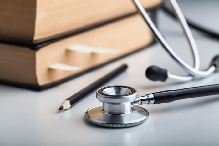 Medical Stethoscope with pencil and book