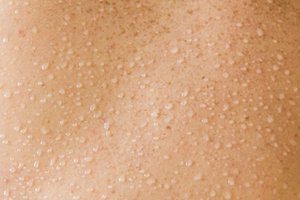 beads of sweat on skin