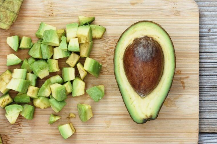 Closeup avocado. Avocado Sliced and diced in salads.