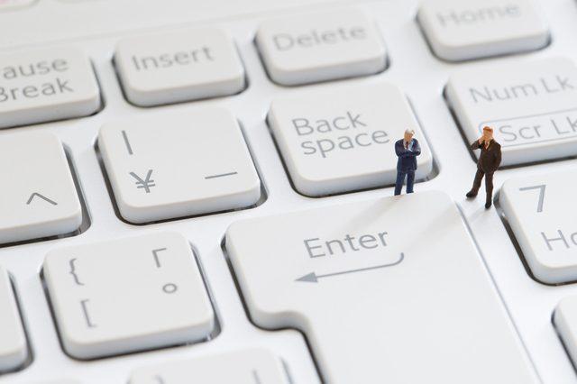 Keyboard and businessmen