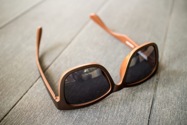fashion sunglasses on wooden table