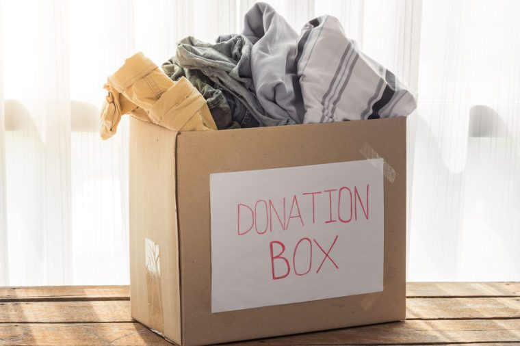 Clothing donation box on wooden background