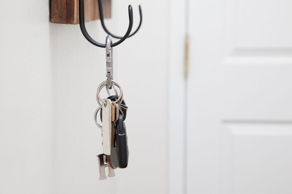 keys for home and car hang on a metal hook