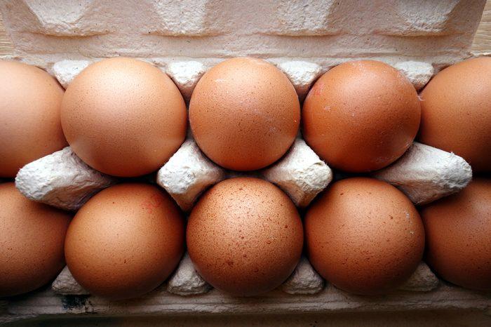 Organic eggs in a box, overhead view