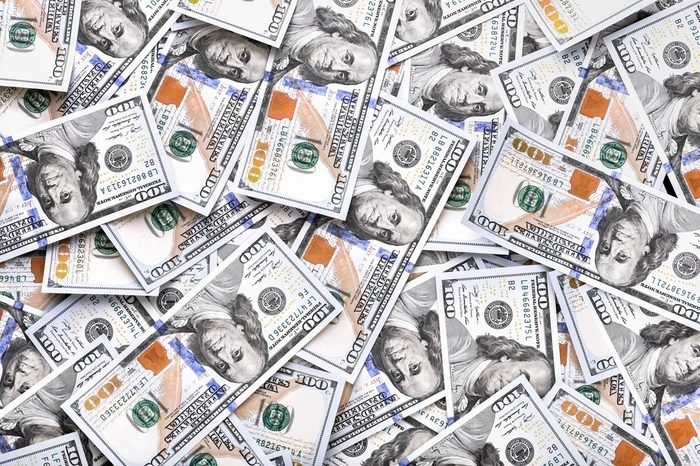 A pile of one hundred US dollars - Banknotes. Cash of hundred dollar bills , dollar background with high resolution
