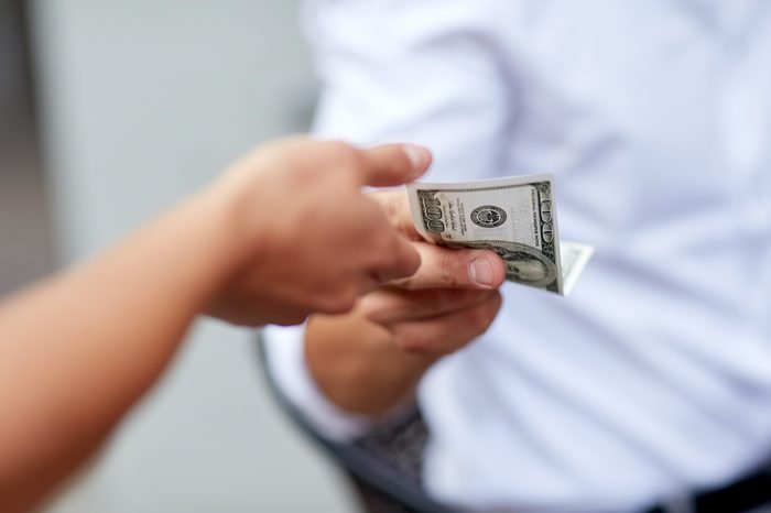 business, finances, payment, charity and people concept - close up of hands giving and receiving dollar money