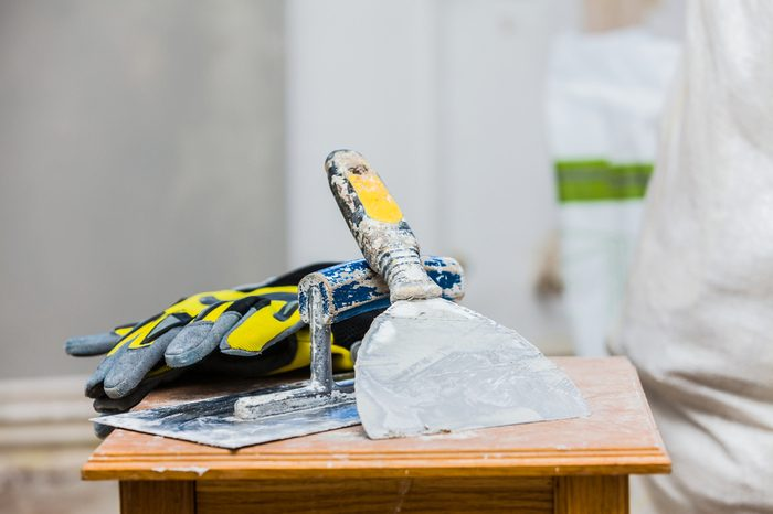 Constructor's tools on construction site - renovation concept.