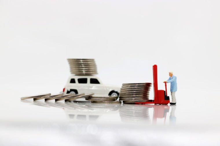Miniature people: workers transport coins money with car, Concept of financial,retail,money saving and business.