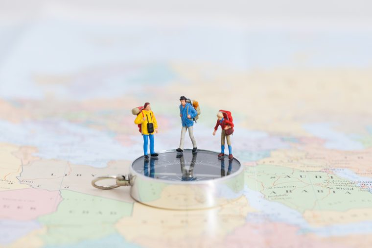 travellers on world a map