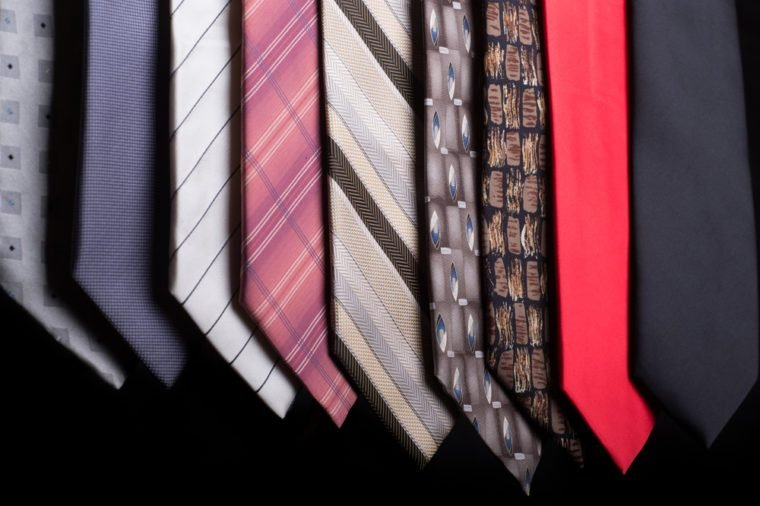 An assortment of different colorful neckties each with a different style and pattern