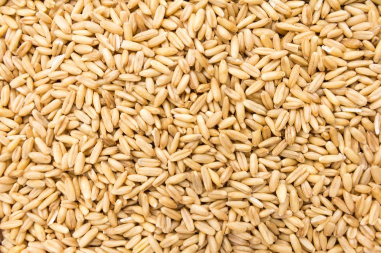 Avena Sativa is scientific name of Oat cereal grain. Also known as Aveia or Avena. Closeup of grains, background use.