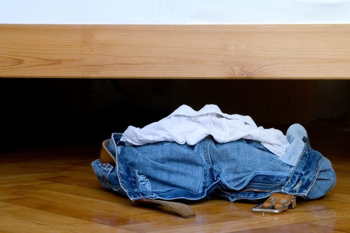A pile of clothes laying on the floor.
