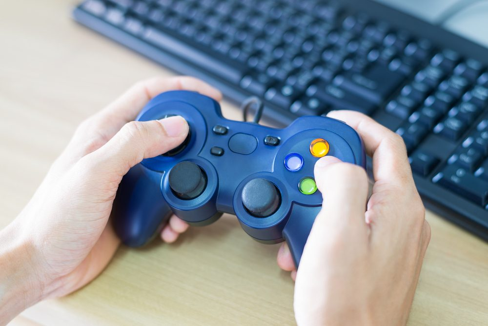 Hands man holds a joystick to play  video game