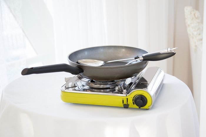 Portable gas stove on the table in restaurant.