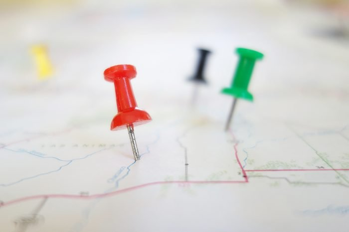 Closeup of push pin tacks in a map