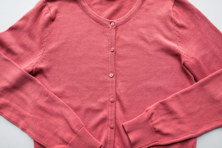 clothing, wear, fashion and objects concept - close up of cardigan