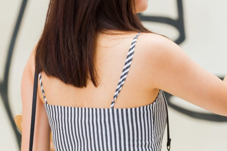 close-up back view asian woman with long hair wearing striped camisole