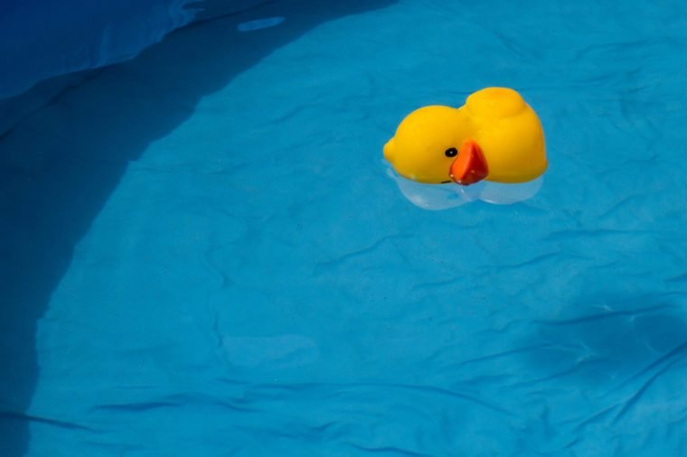 yellow duck floating in a swimming pool