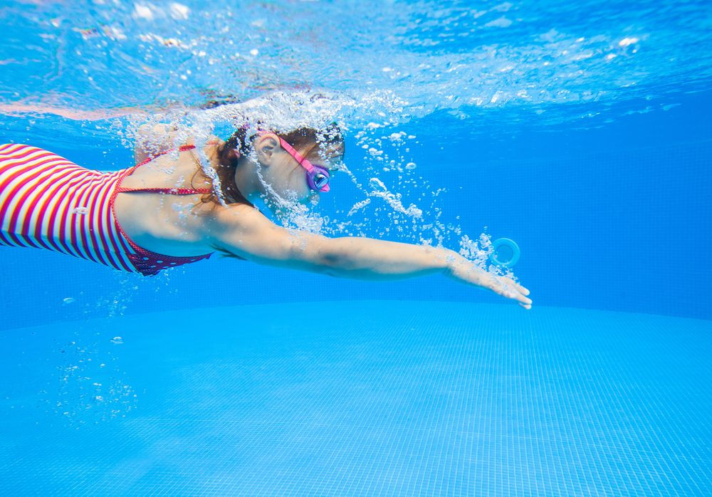 little girl swimming in pool