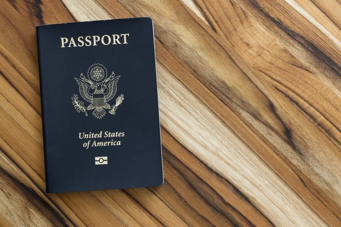 close up of an american passport on a wooden table for a travel concept