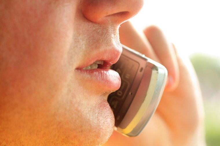 Close-up of man talking on cellular phone