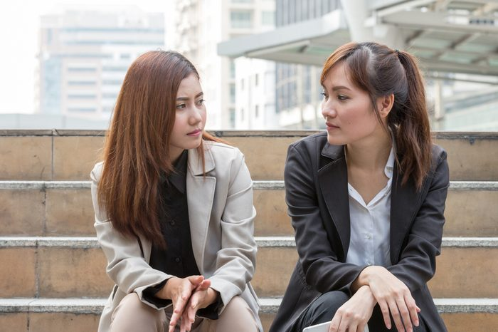 two business women are discussing and share about their work life. They have sympathy for each other