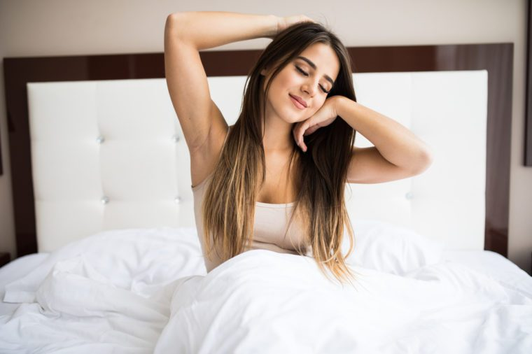 16649e3bc0f Young beautiful girl wake up in the morning at home