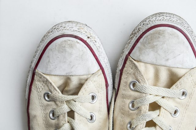 dirty sneakers isolated on a white background