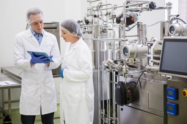 Scientists using tablet to control vats in the lab
