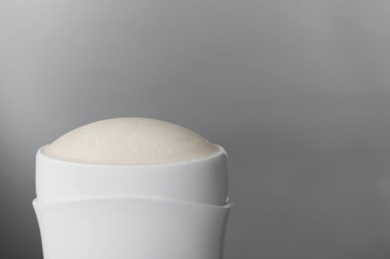 Female deodorant on grey background