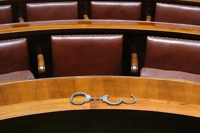 Interior in the empty courtroom with handcuff, law and justice concept