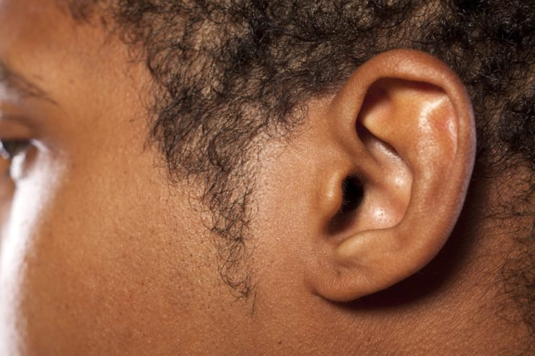 close up shot of the ear of a dark-skinned young man