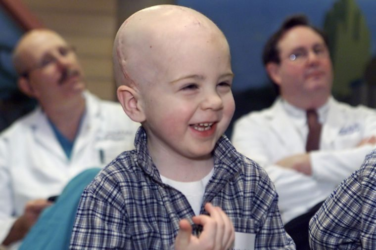 BENTLEY, DUNCAN, TRACY Matthew Bentley, the youngest patient to receive INTRABEAM therapy for a metastatic brain lesion, giggles during a news conference at Hasbro Children's Hospital in Providence, R.I., . Behind Bentley are Dr. John Duncan, left, and Dr. Thomas Tracy, right, two of a team of doctors that removed the tumor from the 4-year-old