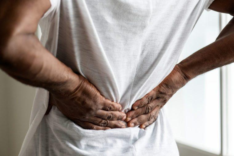Black man suffering back pain