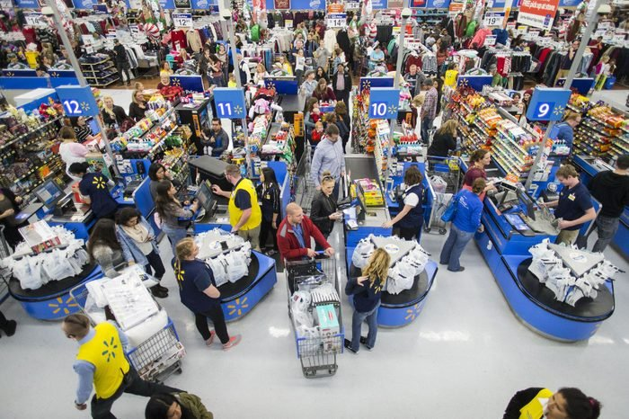 Customers leave happy from a Walmart store in Bentonville, AR, with their Black Friday items on . This year, Walmart stocked its digital and physical aisles with more than 1.5 million televisions, nearly two million tablets and computers and three million video games